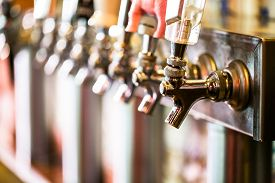 stock photo of draft  - Close up of beer lines for draft beer in restaurant.