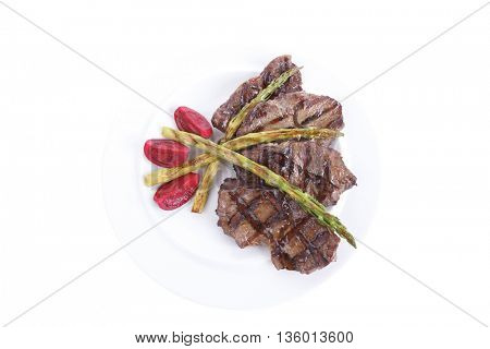 grilled red beef pork meat bbq steak fillet with asparagus and hot pepper served on plate isolated o