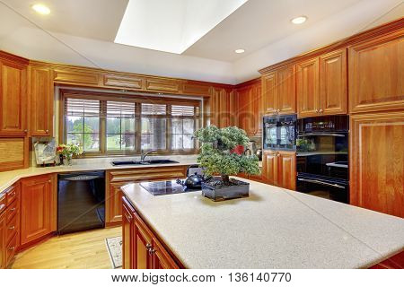 Brown Wooden Kitchen Interior With White Ceiling And Skylight.