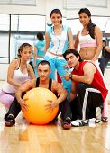 group of people at the gym with their trainer