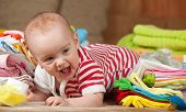 stock photo of babygro  - baby girl with heap of children - JPG