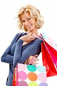 Shopping woman with bags smiling isolated over a white background