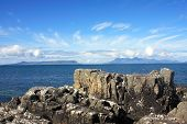 stock photo of eigg  - The Isles of Eigg and Rum from Mallaig in the Scottish Highlands - JPG