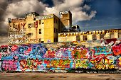 Impressive sky over graffiti'd building