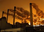 stock photo of global-warming  - **Note slight graininess,  best at small sizes.Coal plant emitting pollution. Burning coal is a leading cause of smog acid rain global warming and air toxics. In an average year a typical coal plant generates: 3700000 tons of carbon dioxide (CO2) the pri - JPG