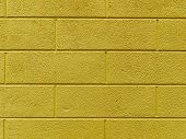 brick wall with yellow tint