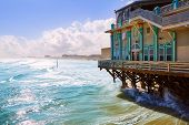 Постер, плакат: Daytona Beach in Florida with pier and coastline USA