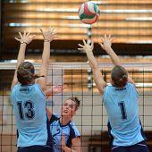 KAPOSVAR, HUNGARY - SEPTEMBER 11: Zsanett Pinter (C) in action at the Hungarian NB I. League volleyball game Kaposvar (blue) vs Budai XI. SE (light blue), September 11, 2011 in Kaposvar, Hungary.