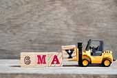 Toy Forklift Hold Block Y To Complete Word 6 May On Wood Background (concept For Calendar Date For M poster