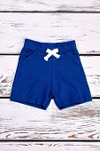 Baby Boy Casual Summer Shorts. Toddler Boy Natural Cotton Shorts On Vintage Wooden Background, Top V poster