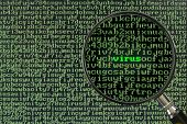 foto of virus scan  - Magnifying glass focusing on the word Virus on a screen full of alphanumerics - JPG