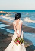 Beautiful Bride In Luxury Wedding Dress With Bouquet At The Sea Side. Wedding By The Sea. Bride Walk poster