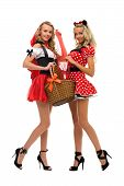 Two women in carnival costume.   Little Red Riding Hood and mouse shape