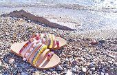 Bohemian Greek Sandals Advertisement On The Beach - Greek Leather Sandals poster