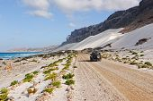 Ocean, Mountain, White Dune And Car