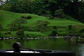 Zen garden with water scoop on well