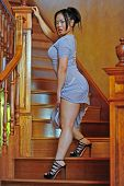 A Beautiful Asian walking up the stair