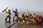 Hunters Against Wild Animals. Miniature Plastic Figures. Soft Focus Effect. poster