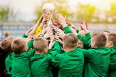 Kids Celebrating Soccer Victory. Young Football Players Holding Trophy. Boys Celebrating Sports Cham poster