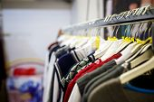 Children Clothes On Hangers In A Room. Wardrobe With Boys Clothes On Hangers. Shopping And Consumer poster