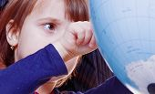 Knowledge And Science Concept. Cute Child Girl Looking At The Globe And Teaching Geography. poster