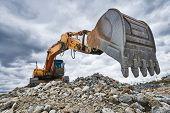 excavator loader machine at demolition construction site poster