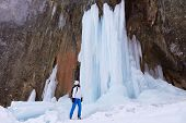 Woman Hiker Next To A Tall Frozen Waterfall During A Winter Hike At Seven Ladders Canyon (7 Scari) I poster