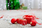 Beautiful Red Christmas Gift Boxes, Red Decorations, Christmas Balls And Lights On Floor Near Fir Tr poster