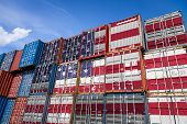 The National Flag Of Usa On A Large Number Of Metal Containers For Storing Goods Stacked In Rows On  poster