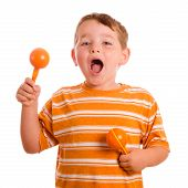 stock photo of maracas  - Happy child playing maracas and singing isolated on white - JPG