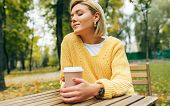 Portrait Of Pretty Young Woman Drinking Coffee At Terrace Cafetaria In The Park. Female In The City  poster