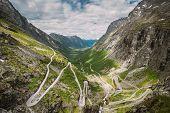 Trollstigen, Andalsnes, Norway. Cars Goes On Serpentine Mountain Road Trollstigen. Famous Norwegian  poster