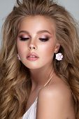 Young Blond Girl With Gentle Bridal Makeup, Perfect Skin, Volume Hairstyle And Closed Eyes. White Ea poster