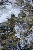 Slow Shutter Speed, To Show Water Flowing Over Rocks With Ice Formations. Flowing Water. Selective F poster