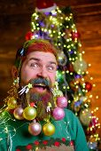 Cheerful Bearded Man With Decorated Beard. New Year Party. Christmas Beard Decorations. Winter Holid poster