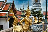 Beautifully Stunning Gold Statue Of A Kinnara, A Beloved Mythical Half-human, Half-bird Creature On poster