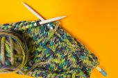Knitting. Knitting Needles And Multi-colored Threads. A Ball Of Thick Thread. poster