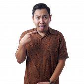 Asian Man Wearing Batik Shirt Shows His Tongue, Sick Person Sticking Tongue Out poster