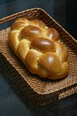 foto of doughy  - challah bread in a basket - JPG