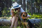 Woman Hugging Her Dog In Nature. Woman Hugging Dog In Forest Nature. Close Up Of Woman And Dog. Pet  poster