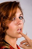 Redhead Girl With Finger On Lips