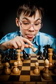 wunderkind play chess. Nerd boy.