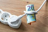 White Electric Cable With Plug Tied To A Knot On A Roll Of Euro Banknotes. Cost Of Electricity And E poster