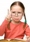 Cute little girl is showing