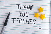 Thank You Teacher. Lined Paper Notepad With Origami Stars And Words Thank You Teacher. Close Up. poster