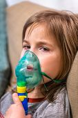 Cute Baby Girl Breathes Through Nebulizer Inhaler. Health poster