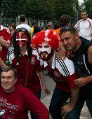 Denmark Fans Pose Near Stadium