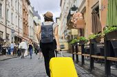 Traveling Woman Tourist In Hat With Backpack And Suitcase Walking Along Street Of Old Tourist City,  poster