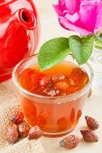 Rose Hips Tea, Red Teapot And Rose-hip Flowers