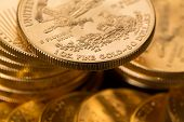picture of treasury  - Stacks of gold eagle one troy ounce golden coins from US Treasury mint - JPG